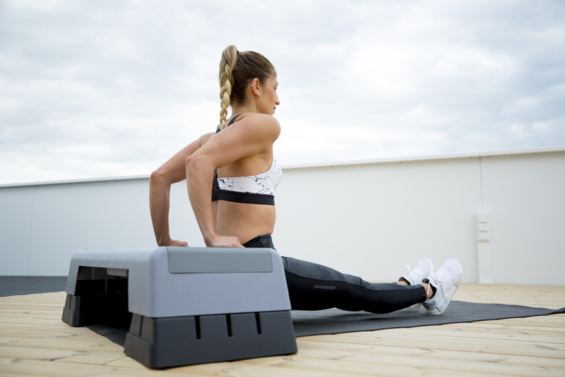 Woman is doing a triceps dip