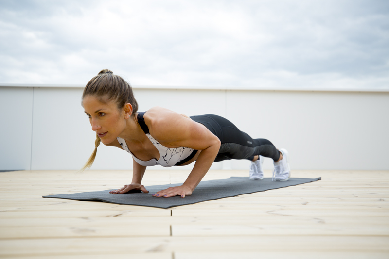 Woman is doing 2-2-2 push ups