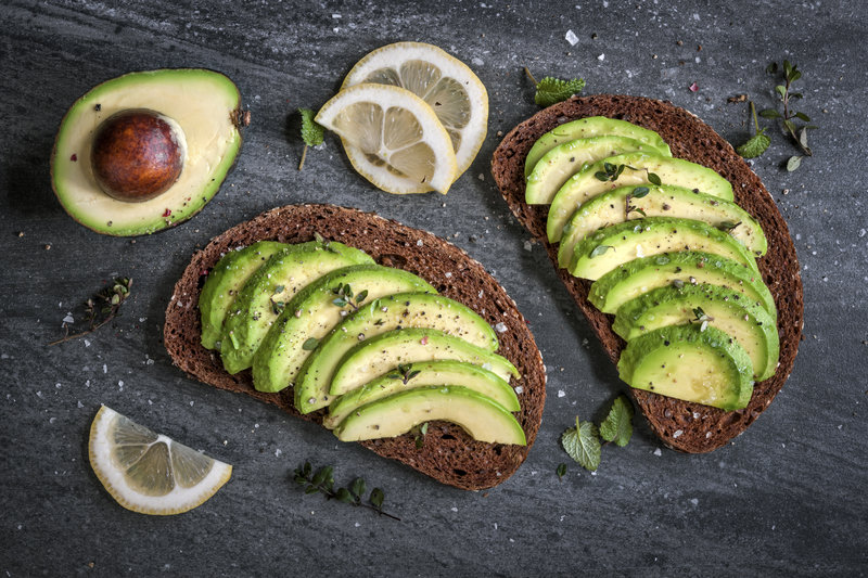 Two slices of avocado on bread
