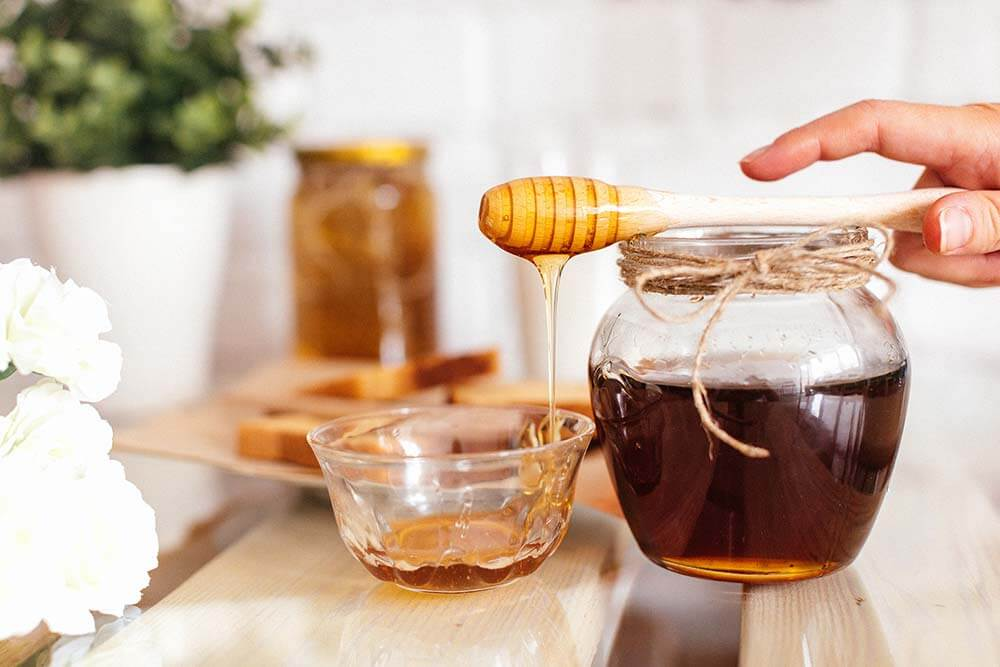 a glass of honey