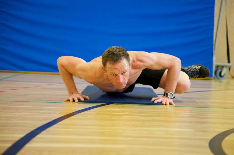 Athletic man doing bodyweight training.