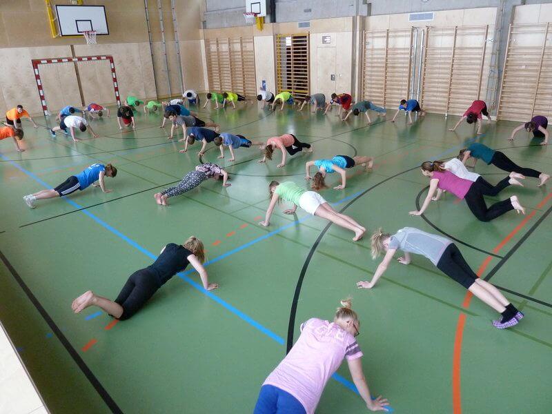 School class is doing a bodyweight training.