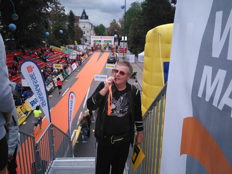 Male runner with his medal after the competition.