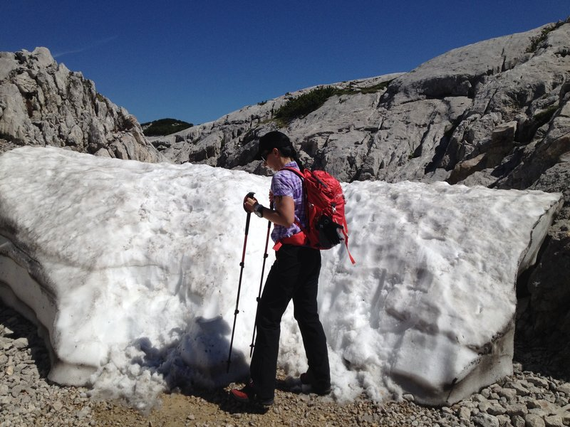 Young woman hiking in the snow.