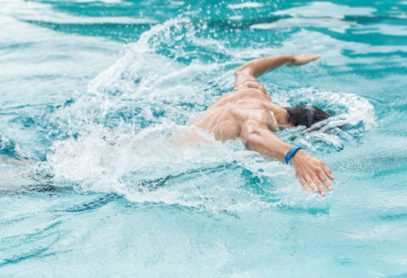 Athletic man swimming.
