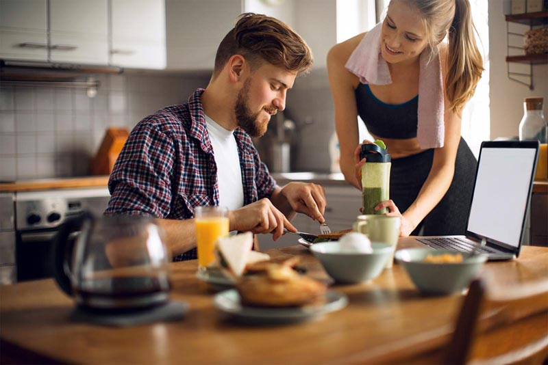 Young couple having breakfast together.