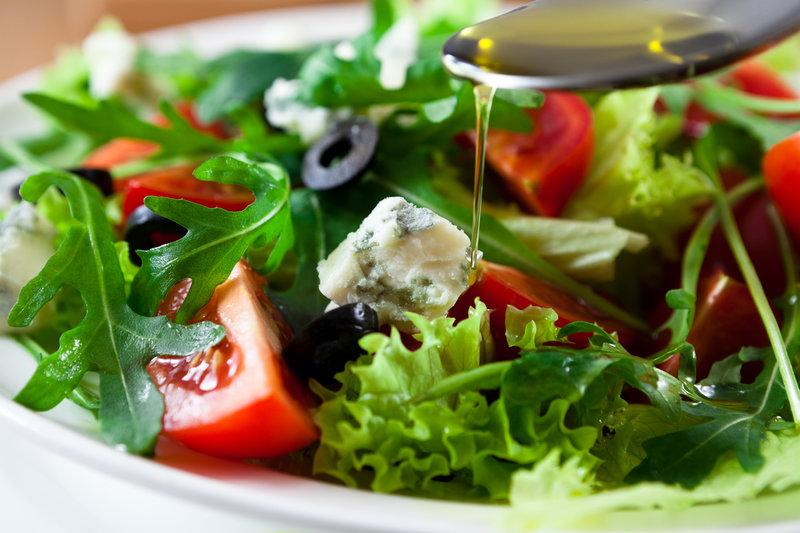 A plate with green salad and tomatoes