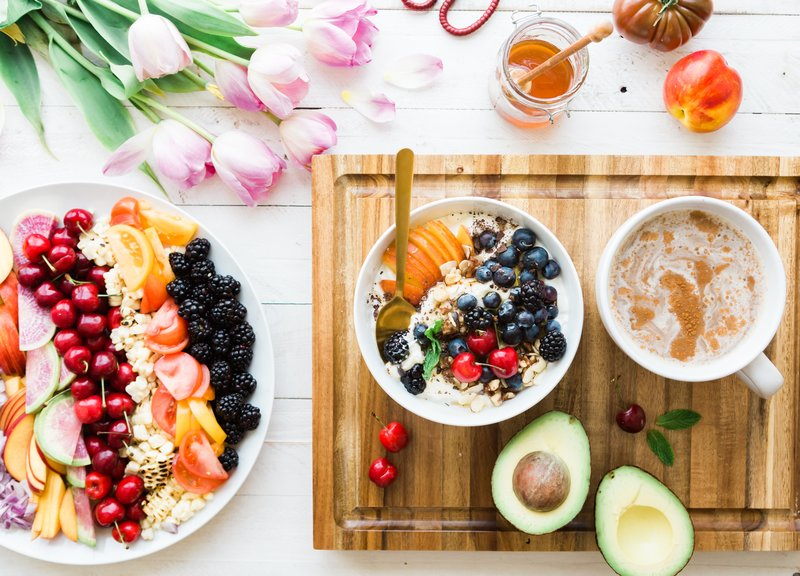 A colorful breakfast on a wooden tablet