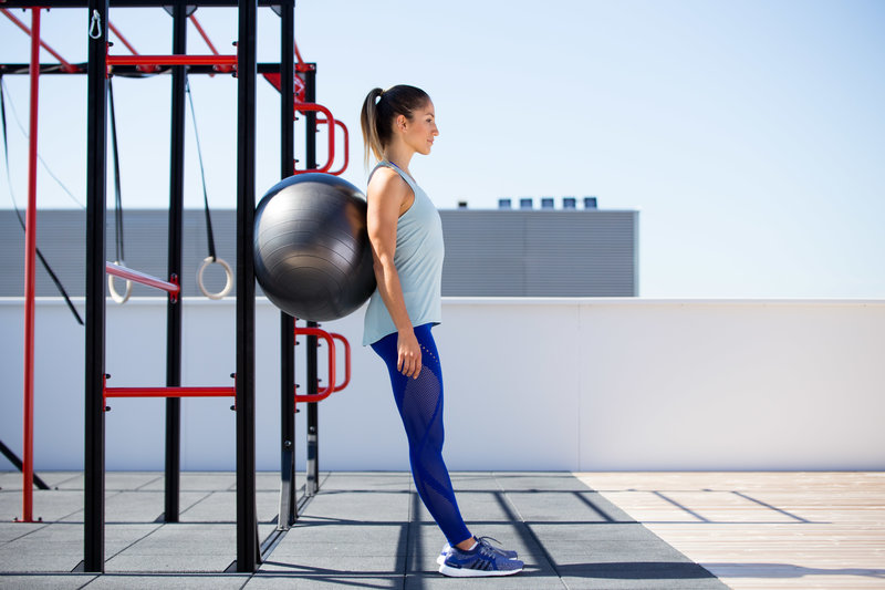 Woman doing a ball squat