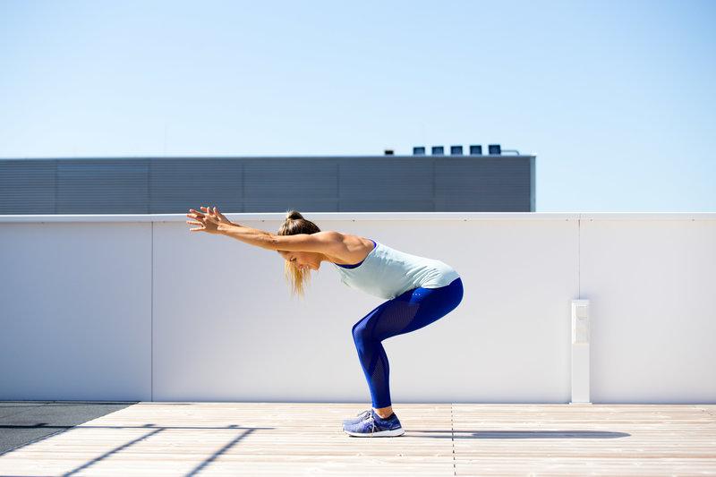 Woman doing an excessive forward lean while squatting