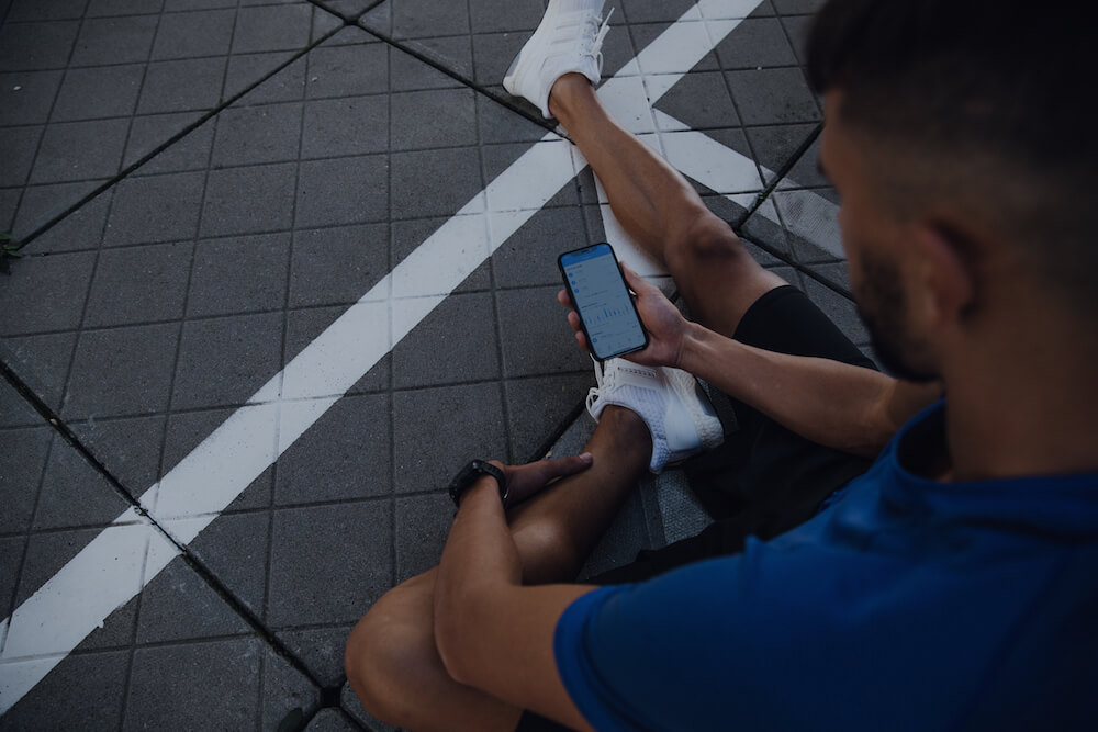 A runner takes a look at his progress in the Runtastic App
