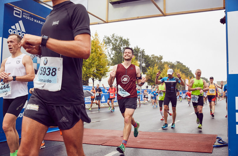 a young guy finishing a marathon