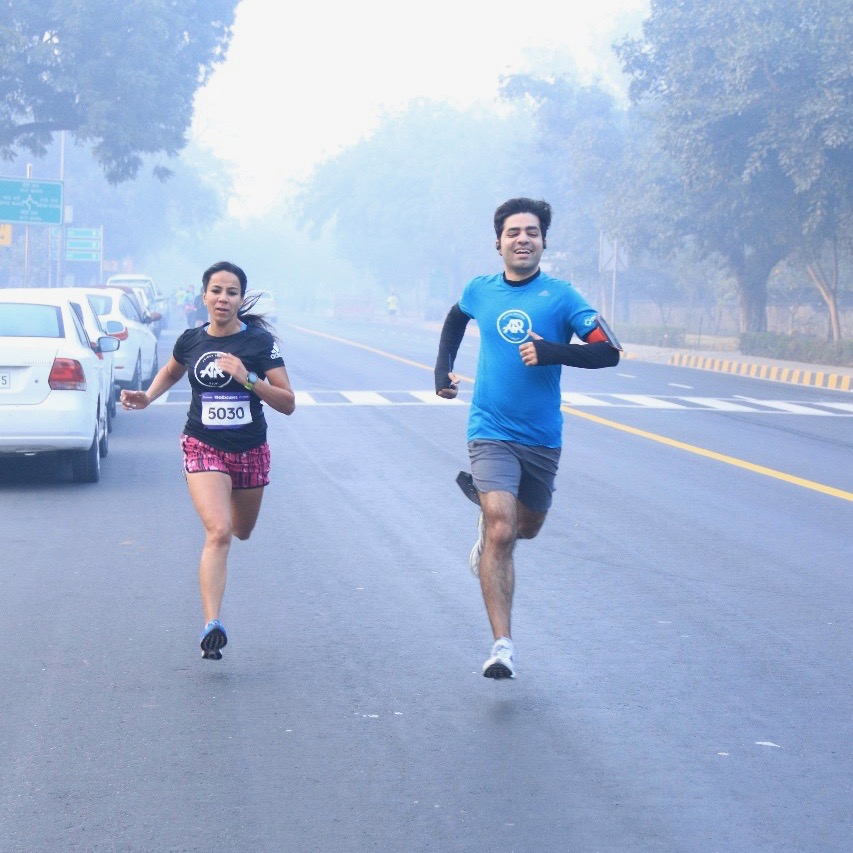 A man and a woman running on the street