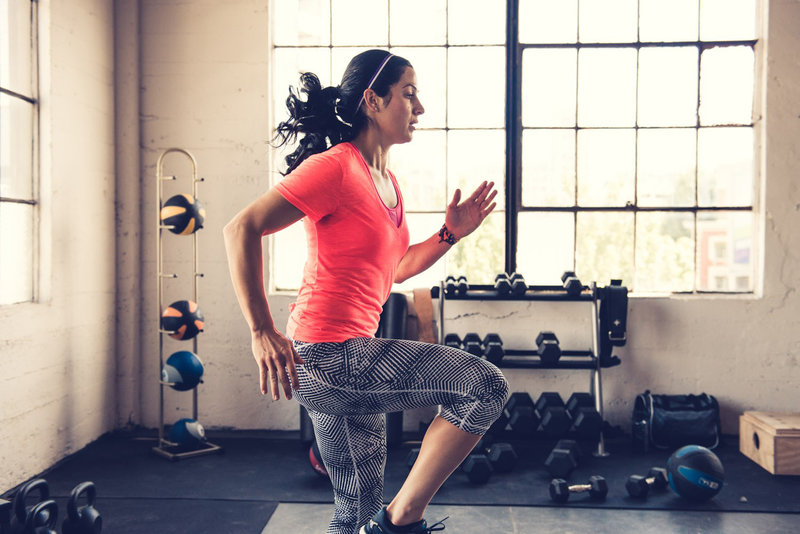 A woman doing a bodyweight training in the gym