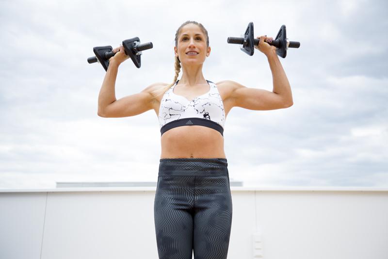 Woman is doing a shoulder press