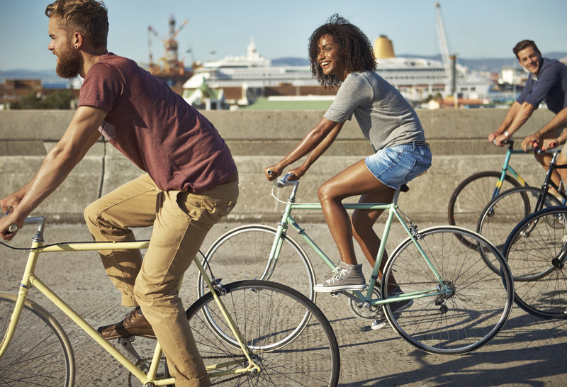 A women and two men on bikes.