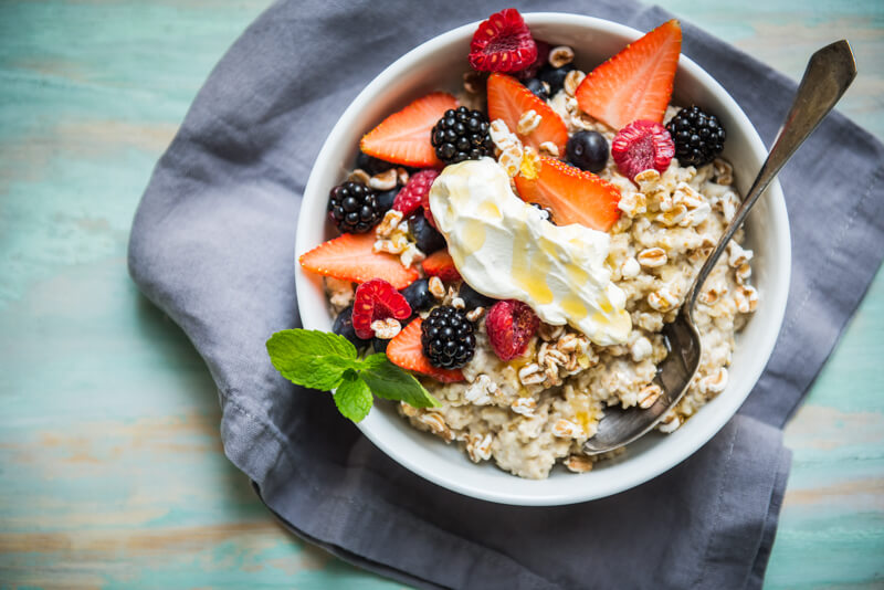 A bowl of fresh fruits and oatmeal