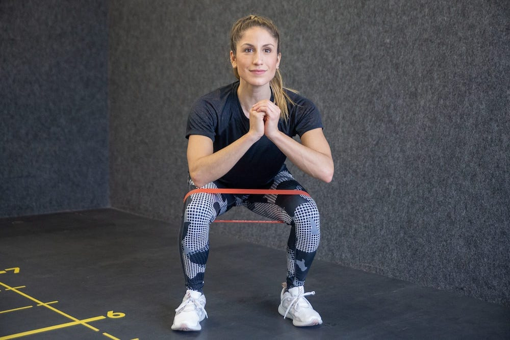 Squat with Side Raise RB