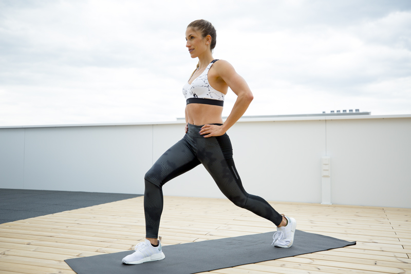 Woman is doing a pulsing lunge