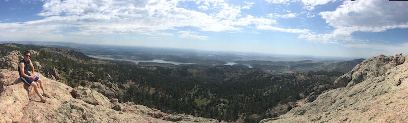A young man on the top of Horse Tooth Mountain in Fort Collins, Colorado