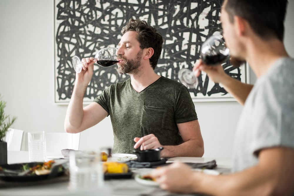two people drinking wine
