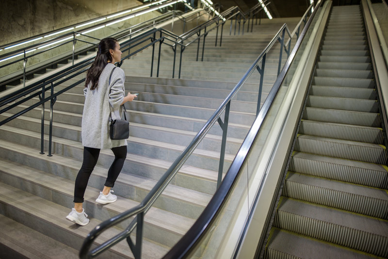 Woman walking up the stairs