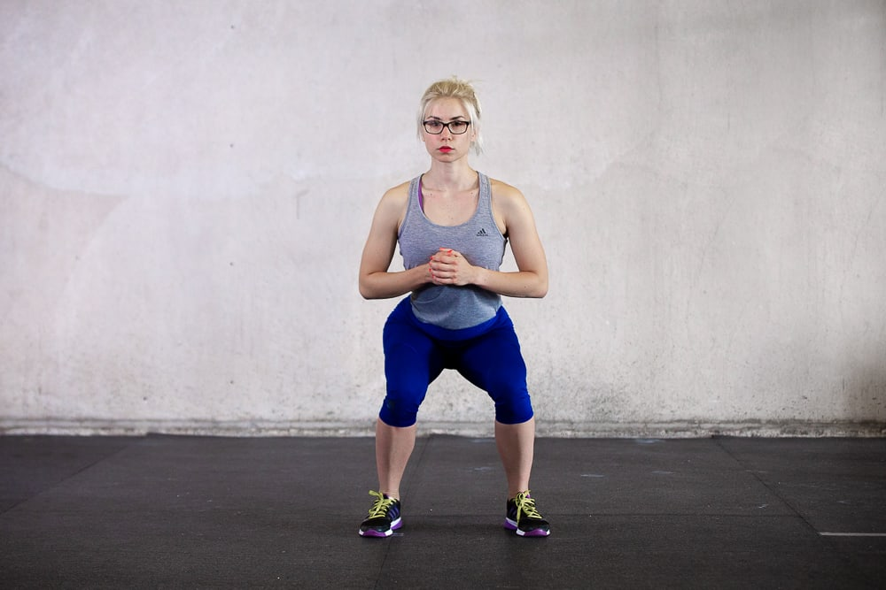knees going inward during a squat