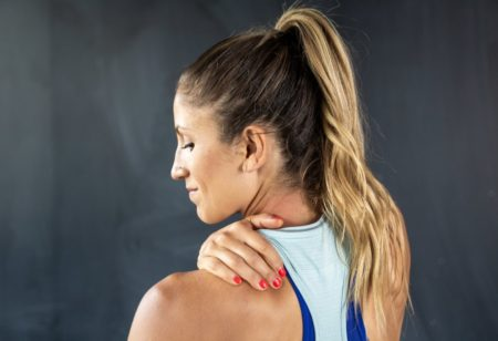 Woman feeling sore in her traps