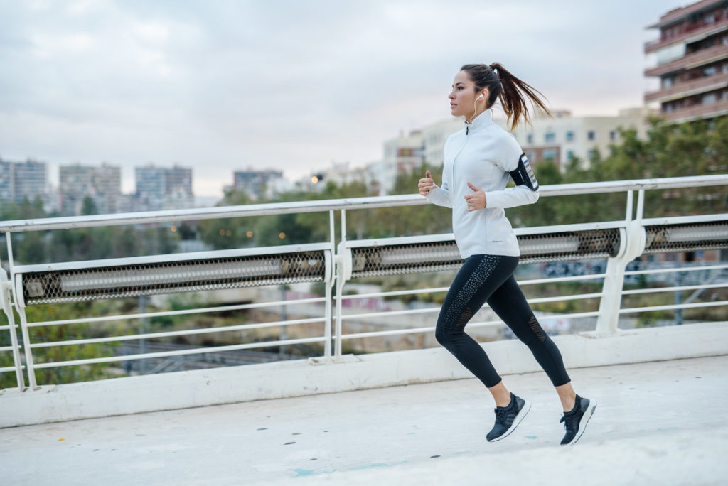 A woman running in the city