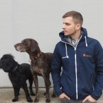 Dog- Coach Manuel Kregl with his two dogs.