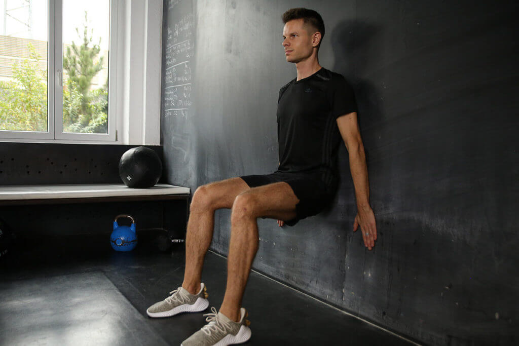 A man doing a wall sit