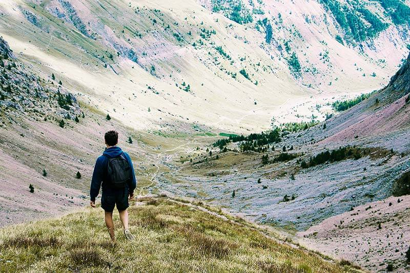 A young guy hiking in the mountains