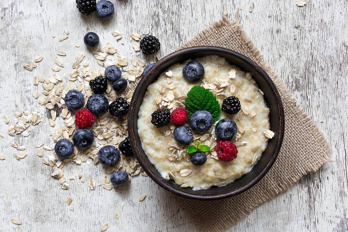A bowl full of oatmeal and fruits is great for stress relief