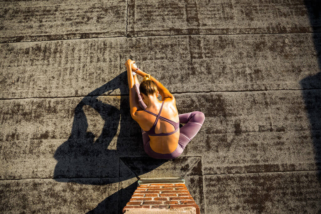 Woman doing exercises to get active in the morning