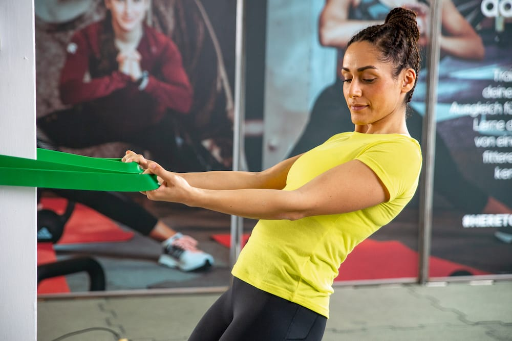Woman using a resistance band