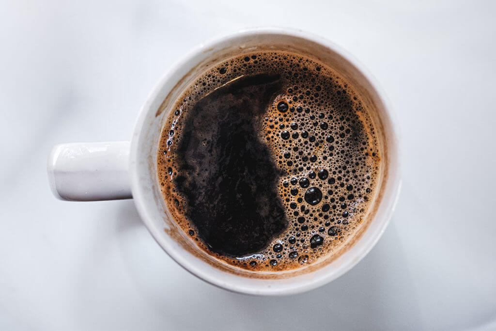 Close up of a cup of black coffee