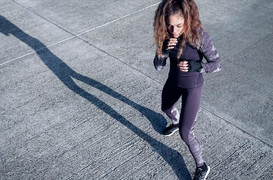 Young woman is training outside