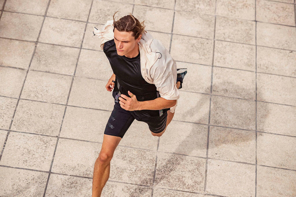 Young man is running in Adidas clothes