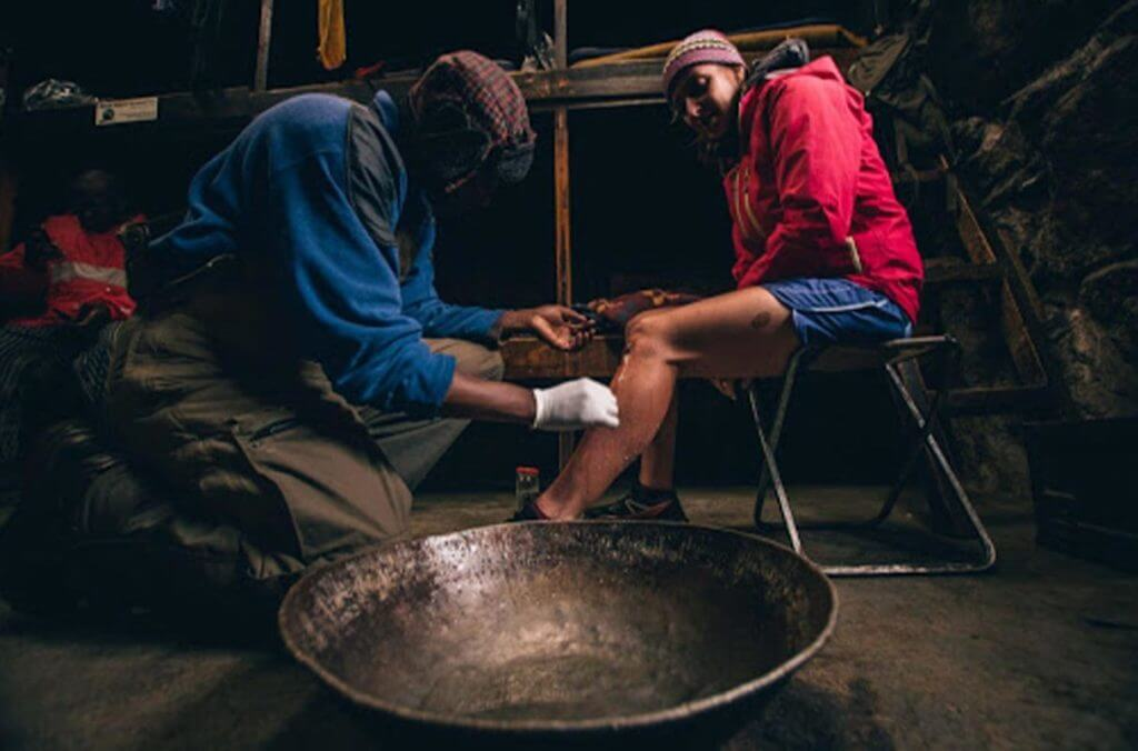 Couple in a tent - treating wounds