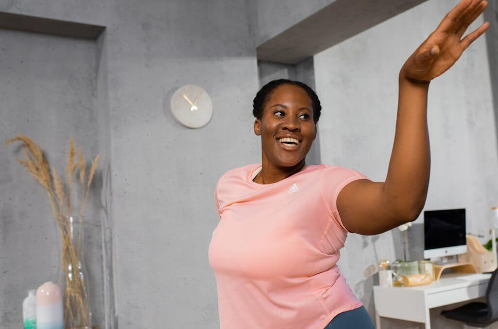 woman is smiling while dancing