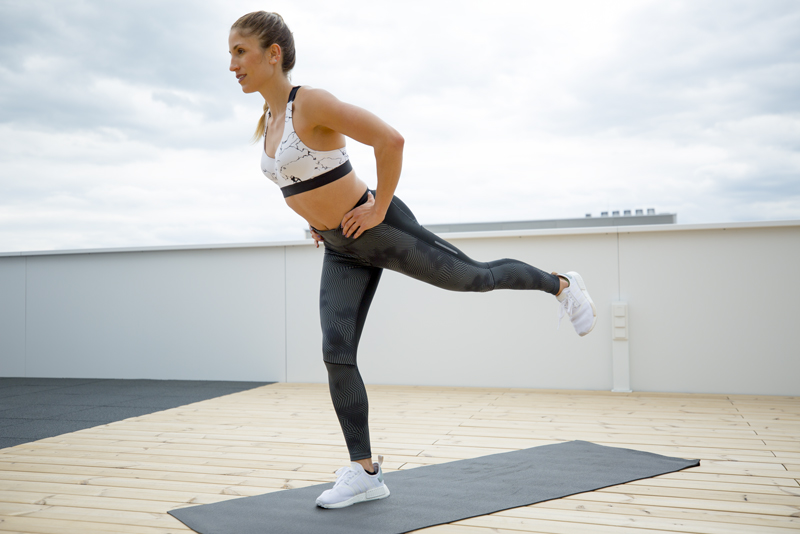 Woman is doing a lunge booty lift