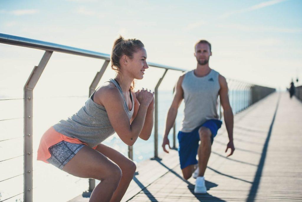 Men and woman training legs