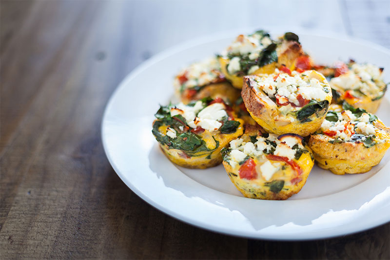 A plate with egg muffins with vegetables