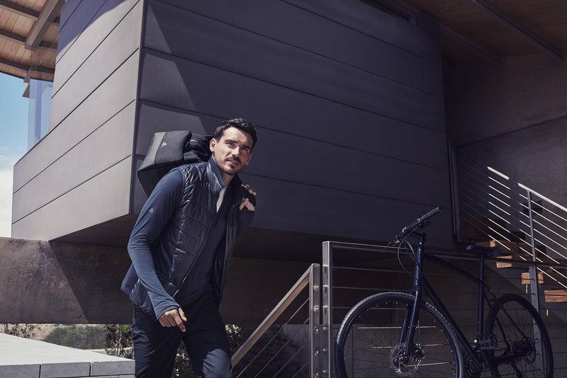 A man is getting ready for biking.
