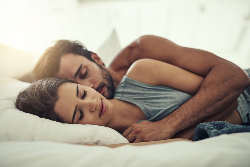 A young couple is snuggling and sleeping