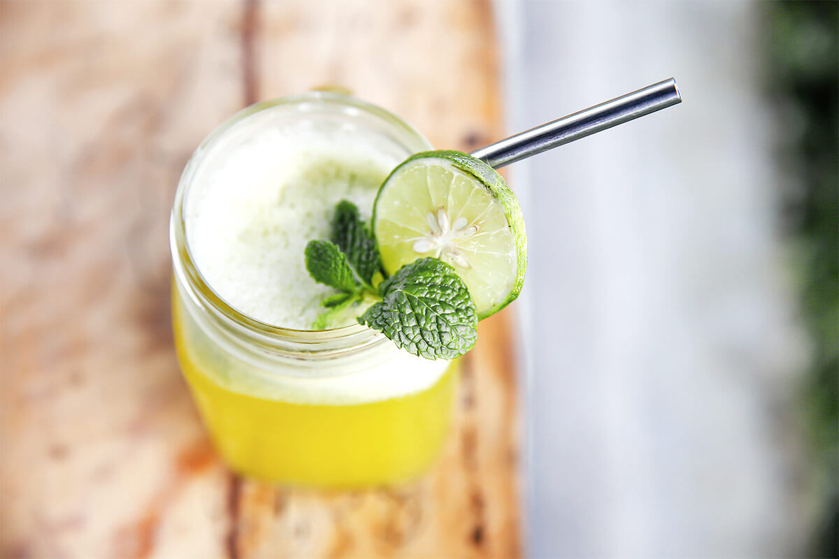 fruit juice with reusable metal straw