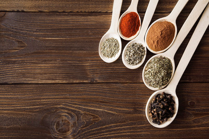 Spoons with different spices