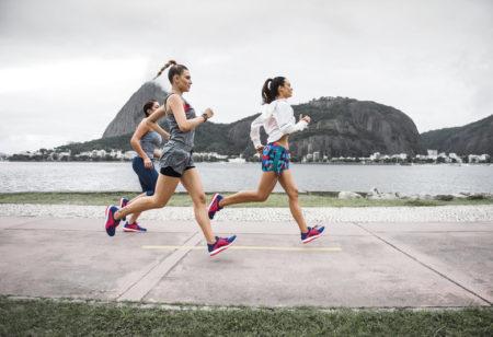 Three friends running together.