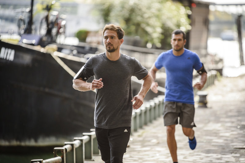 Two men running in the city