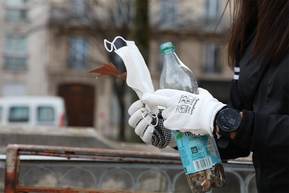 discarded mask and plastic bottle